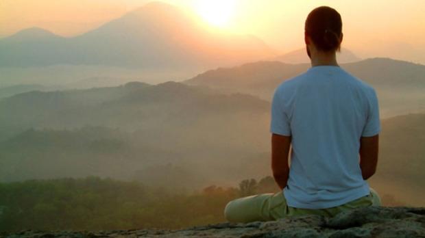 man sunrise meditatiion